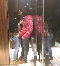 'Elevator kiss': Kim Kardashian and Kanye West shared a romantic smooch while riding an elevator in NYC in this romantic selfie posted on Monday