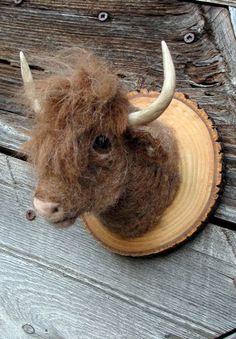 Faux miniature needle felted animal trophy.  via Etsy.