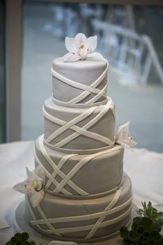 gray wedding cake wrapped in white...could use an orange flower or two