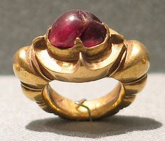 Ring Inlaid with Oval-Shaped Red Stone with Ribbed Hoop  Period: Central Javanese period Date: 8th–early 10th century Culture: Indonesia (Java) Medium: Gold with red stone