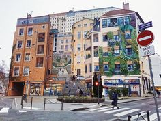 """Le mur des Canuts"""" is the wall depicting the silkworkers in Croix-Rousse Lyon  at one time the largest painted mural in Europe. Created in 1987 to show architectural features of the quarter it was then updated in 1997 to show the people of Croix-Rousse and updated again in 2013 to reflect the evolving neighbourhood (including ageing the people by 15 years and expanding the families)."""