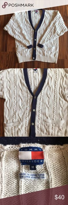 Vintage Tommy Hilfiger Cardigan - Minor Stains Condition - 7/10! This sweater shoes signs of bleach staining throughout blue fabrics. The rest of the sweater is in great condition.  Brand - Tommy Hilfiger   Size - Mens Medium  Color - Ivory and Navy Blue   Material - Cotton  Origin - Made in Hong Kong Tommy Hilfiger Sweaters Cardigan