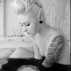 Love the brows , the cheek contour ,  the black bathtub water and of course the tattoos ... A+