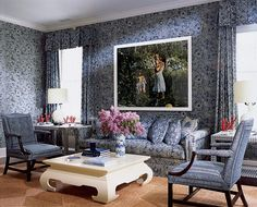 """""""A Tina Barney photograph of Aerin and sons hangs in the upstairs sitting room, decorated in batik by Mark Hampton, the very classic New York designer."""" Photography by Eric Boman. """"From the Archives: Aerin Lauder's Wainscott Home, """" Vogue (July Aerin Lauder, Estee Lauder, Aspen, Die Hamptons, Alexa Hampton, East Hampton, White Decor, Living Spaces, Living Rooms"""