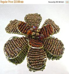This brown glass bead flower brooch is incredible and unusual!  It features a large wired flower filled with tiny amber brown glass beads, topped with a smaller flower also... #ecochic #etsy #jewelry #jewellery #vintage