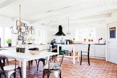 rustic brick or terracotta floors might be really cool in the sunroom to make it feel more outdoorsy