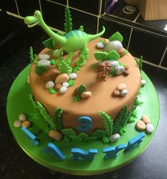 Dinosaur themed cake for Masons 2nd birthday. We can buy him dinosaur figures and a dinosaur book that teaches him the names!