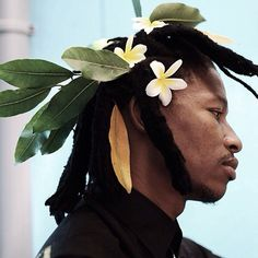 Got a soft spot for men with flowers in the hair | Repost of @atangtshikare by @trevor_stuurman