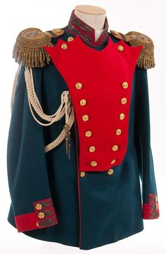 Imperial Russian tunic of a senior officer of the Moscovski Guard Infantry Regiment, circa 1907. Imperial green wool double breasted tunic with red collar, cuffs and piping. Collar and cuffs richly embroidered in a gold bullion oak leaf pattern, now age darkened, unique to this regiment. Has a matched pair of gold bullion epaulettes, faced in red, with applied silvered Nicholas II crowned ciphers, and a white adjutant's aiguillette with silver crowns and points.