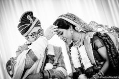 Candid photo of Bride and Groom in Bengali Wedding Ceremony in Hyatt Jersey City by PhotosMadeEz - Best photographers for Photo Journalism/Editorial Wedding Photography. Featured in Maharani Weddings. Best Wedding Photographer PhotosMadeEz Award winning Photographer Mou Mukherjee. Fusion Wedding of Deepa and Peter. Sindoor
