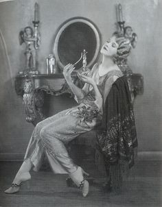 "Thalia Barbarova, 1920s ""Opulent brocade shawls like the one on actress Thalia Barbarova's chair were popular, with some of the more luxurious coming from France."""