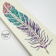 """Adorn your home with this beautiful one of a kind piece of Swarovski rhinestone art! This beautiful piece has been created with Swarovski . Feather Wall Art, Tribal Feather, Button Art, Button Crafts, Rhinestone Crafts, Art Perle, Diamond Paint, Summer Crafts For Kids, Dot Art Painting"