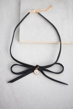 Black, leather bowtie choker necklace.