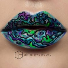 Abalone | I asked on snapchat what people saw and I got space, another universe, oil spill, lots said gasoline, and abalone (which was my actual inspiration for this lip art). What do you see? Products used: @anastasiabeverlyhills 'Midnight', 'Paint' liquid lipsticks and 'Electro' lipgloss. @colourpopcosmetics 'DR. M' liquid lipstick. @makeupforeverofficial Flash Palette. @mehronmakeup 'Opal' Precious Gem Powder. @smithcosmetics # 202 brush.