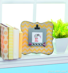 Stitch a sweet image and attach it to a frame for an oh-so-sweet piece of nursery decor.