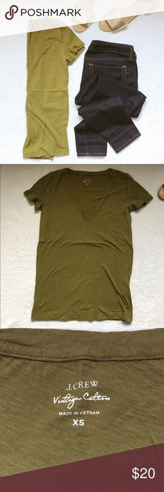 j crew v-neck tee J Crew vintage V-neck tee in olive green, an of-the-moment color! Lightweight and super soft. Has a great broken in feel. Size XS. Worn once and in excellent condition! J. Crew Tops Tees - Short Sleeve
