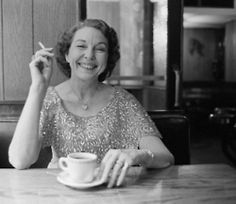 Edna Milton drinking coffee.