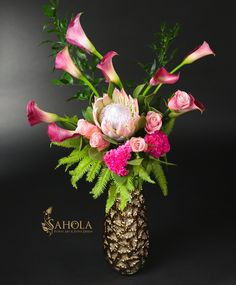 Tall extravagant flower arrangement with pink callas, pink roses and protea in a chic vase made by New York Floral Designer SAHOLA  This and other unique flower arrangements available at www.saholany.com #saholaflowers  #bouquet #flowerstagram #floraldesigner #newyorkflorist