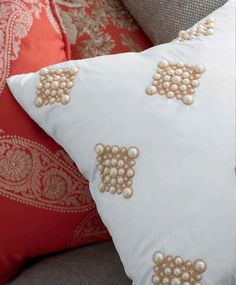 Our pearl diamond pillow in ivory is dressed for success with its array of pearl bead clusters with gold bullion embroidery. Hand crafted.