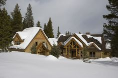 A timber frame home in the snow. Does anything look more natural?