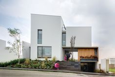 Love the plants at the front entrance Casa Valna / JSa Arquitectura