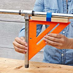 Twist the shelf pipe until it is 90 degrees to the frame.