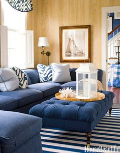Designed by T. Keller Donovan, this blue-and-white library in a Nantucket cottage has something that all of Donovan's blue-and-white rooms have: a punch of natural tones.