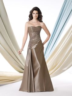 Strapless silk taffeta A-line gown with hand-beaded softly curved neckline, beaded embroidered overlay bodice with side pleated asymmetrically dropped waistline, sweep train. Matching shawl and removable straps included. Please Note: Neckline is trimmed with hand-beading (not shown in this photo). Sizes: 4 – 20