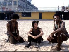 "The Warriors Snow, Cowboy and Cochise relaxing on the beach in Coney Island. If you look, you can see the ORS of their ""Warriors"" tag on the bath house wall."