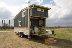 This is Raw Design Creative's Homestead Tiny House on Wheels — with two folding decks! This build includes one of the most interesting bed/living/loft situations I've seen. Tiny House Listings, Tiny House Plans, Tiny House On Wheels, Small Room Design, Tiny House Design, Tiny Houses For Sale, Little Houses, Tiny House Exterior, String Lights In The Bedroom
