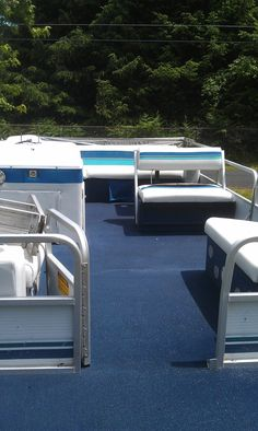 Finished pontoon boat interior.   No grass now!