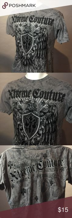 "Xtreme Couture brand MMA style men's tee shirt M Xtreme Couture tee. Rock hard in this unisex Size M vintage tee. All tees in my closet are nicely vintage worn, soft and have small original ""markings"" and such from wear.  Vintage gear with a stylish edge. Rock it back to life wearing this one-of-a-kind shirt. Shirts Tees - Short Sleeve"