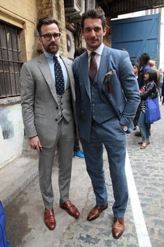 Blue and grey suits on men