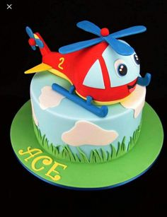 Helicopter Cake: Chocolate mud cakes with milk chocolate ganache. Helicopter Cake, Helicopter Birthday, Airplane Birthday Cakes, Baby Birthday Cakes, Baby Cakes, Cupcakes, Cupcake Cakes, Chocolate Mud Cake, Chocolate Ganache