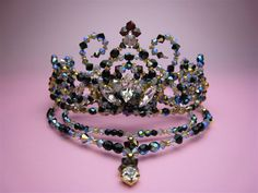 This stunning tiara is ideal for the role of the black swan. It features a special color combination of black Swarovski beads shining in rainbow color sparkle on stage. Hand made and designed by Satsu