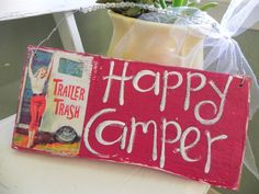 This is one of our best sellers...from cowgirls to beach girls...everyone loves this sign!!! Here is a great red sign for your RV! Give as a gift to your friend that loves to travel! We have layered creamy white, then retro red. Happy Camper has been hand lettered...then vintage inspired Trailer Trash artwork has been added...giving it that retro/vintage feel we all love! This sign is about 10.75 x 5, hand beaded...and has YUMMY glass glitter!!! Finished off with a white bit of tulle!    All…