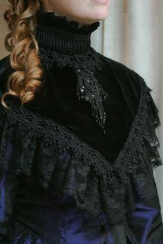 Black Velvet Victorian High Collar - Price: $64.00  Black Velvet Victorian high collar with shirred floral lace off shoulder and high ruffled lace collar. This collar also has a beautiful beaded oval lace fabric cameo in front and black lace venice trim. One size fits most that is the perfect cover-up that will dress up a basic blouse or dress.