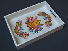 The wooden tray decorated with decoupage technique (traditional Polish folk design), hand-painted with acrylic paint and and secured with several