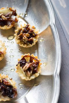 Baked brie cups topped with sweet caramelized onions, spicy nuts and a ...
