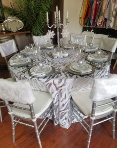 White Faux Fur Chiavari Chair Caps paired with our White & Silver Jazz Sequin Floor Length Table Linen and White Dupioni Napkins
