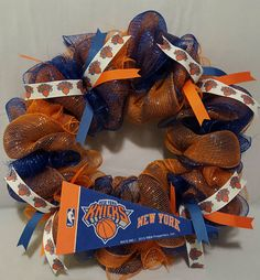 Check out this item in my Etsy shop https://www.etsy.com/listing/488230016/new-york-knicks-inspired-wreath-ready-to