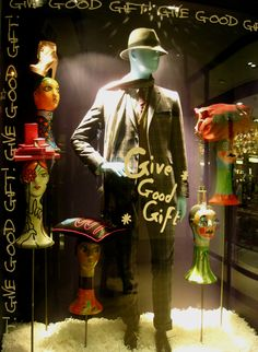 give good gift, pinned by Ton van der Veer Love his classic mens three piece suit and classic matching hat surrounded by vitnage womens mannequin heads with womens gift ideas letting men know this is where they will get the good gift