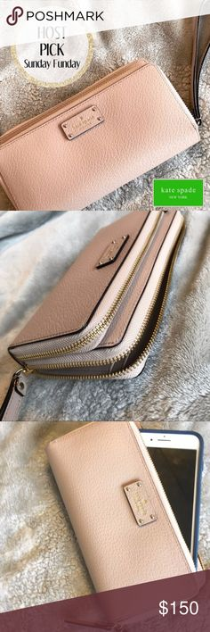 Wristlet Wallet in Blush Rose Pink Very lightly used! I use it as a wallet in my purse during the week, but on weekends I take it out and use it as a wristlet only. I have 2 phones, & it fits both of them (1 on outside pocket, & 1 zipped in middle -including my iPhone 7 PLUS). Then I attach my car key to the wristlet, &if I have my sunglasses, I can stick one arm in side of the wristlet &this thing is an EASY carry-all solution. LOVE IT! Please know that I am always receptive to offers…