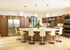 Large Island with curved breakfast bar design and 80mm thick Corian worksurface