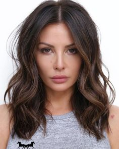 Even if you have dark hair, summer calls for lighter strands. Click here to see 17 examples of dark brown hair with highlights.