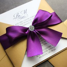 Gold and Purple Wedding Invitation... Switch the gold to  grey and purple to blue? Hmmm.... I like