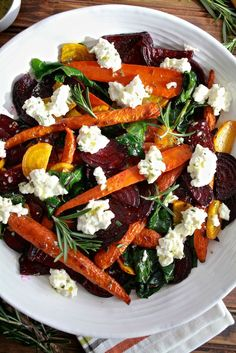 Roasted Beets and Carrots Salad with Burrata Roasted beets and carrots with sautéed beet greens tossed with honey rosemary vinaigrette and topped with burrata. A perfect fall vegetable side dish. - Roasted Beets & Carrots Salad with Burrata from Veggie Recipes, Vegetarian Recipes, Cooking Recipes, Healthy Recipes, Beet Salad Recipes, Vegan Beet Recipes, Health Salad Recipes, Red Onion Recipes, Cake Recipes