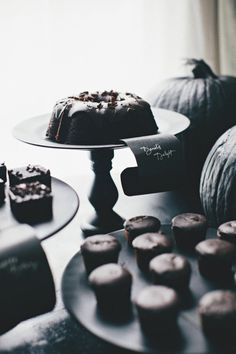 moody, all black dessert table for a Halloween Dinner Party  Photography by rebeccahansenweddings.com, Floral Design by foret-design.com, Design   Styling by stylemepretty.com