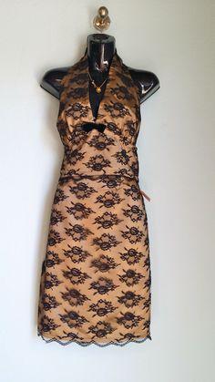 black and gold lace 2 pieces skirt ensemble, size 2, $27 Coach necklace, $59.