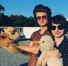 Joe Kerry and Finn Wolfhard holding puppies! Cutest thing ever!